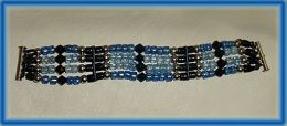 Bracelet with Black, Blue and Light Blue Glass and Sterling Silver Beads on Italian Leather Thong